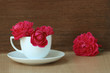 Still life red rose in white coffee cup for decoration