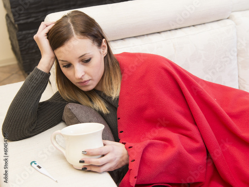woman illness sofa