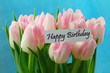 Happy birthday card with pink tulips on blue background