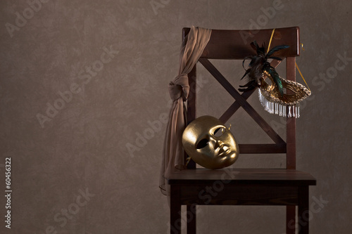 masks on  wooden chair