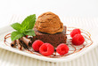 Chocolate Brownie with ice cream and raspberries