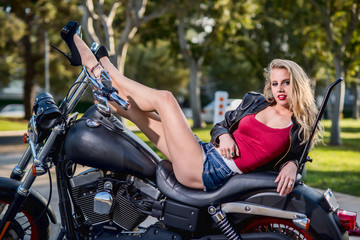 Sexy caucasian blond woman on motorcycle