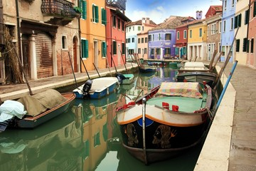 Boats in the canals of Burano island