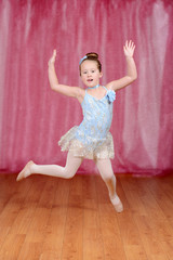 ballerina girl dancing and jumping