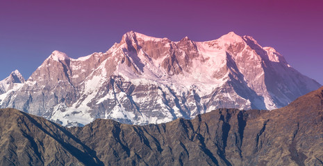 partially red Mountain  Chaukhambha During sunset in Himalaya
