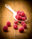 Raspberries on wooden spoon