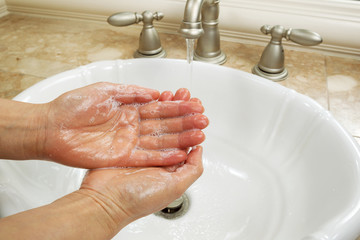 Lathering Hands with Soap for washing