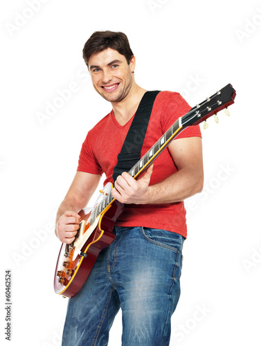 Handsome man plays on the electric guitar