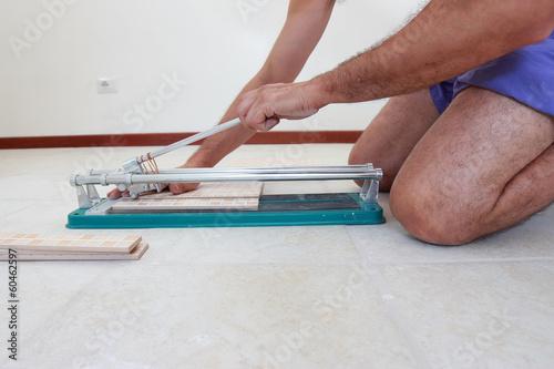 Tiler cutting tiles