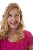 girl makes funny face in closeup over white background