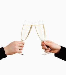 Two Hands Holding Glasses of Champagne Toasting