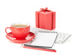 Coffee cup, red gift box and office supplies