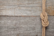 Ship rope knot on wooden texture background - 60464534