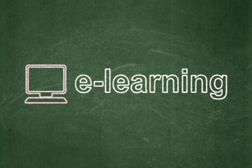 Education concept: Computer Pc and E-learning on chalkboard