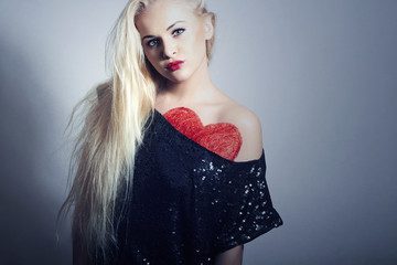 Beautiful Blond Woman with Red Heart.Symbol Under Black Dress