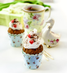 Cupcakes and coffee in Easter or Saint Valentine's Day style