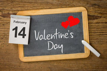 Calendar and blackboard showing February 14, Valentine's day
