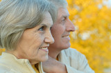 Happy elderly couple at nature