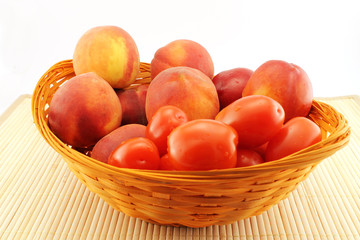 Basket of peaches and tomatoes