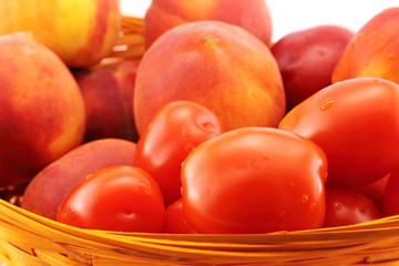 Basket of peaches and tomatoes close-up