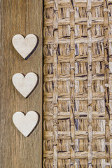 three hearts on wood