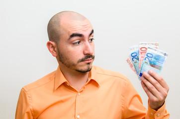 Men portrait with his few dollars left