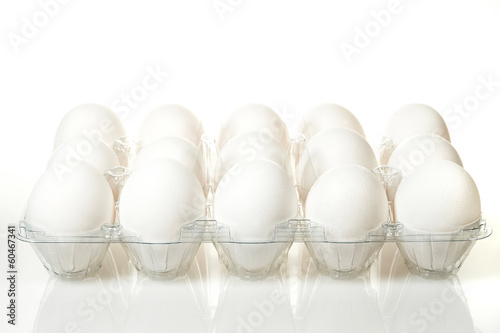 White eggs in a plastic tray