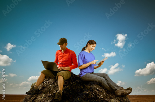 woman and man working outdoors