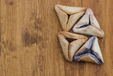 Hamantaschen cookies for Purim on a wooden surface