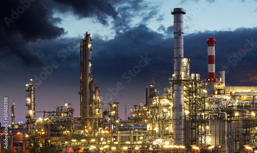 Oil refinery factory silhouette over sunrise