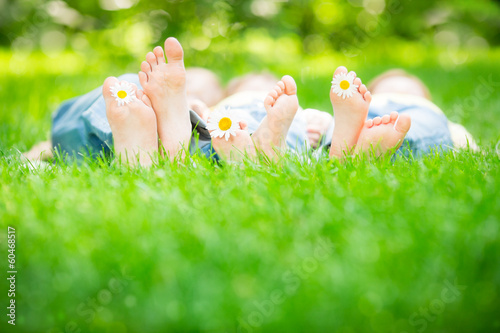 Family lying on grass - 60468517