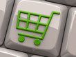 Green shopping cart symbol on computer key