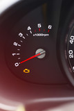 Detail of a tachometer in a car