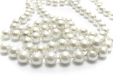 Close up of pearl necklace on white