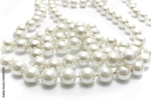 Leinwandbild Motiv Close up of pearl necklace on white