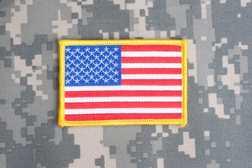 US flag on camouflage uniform