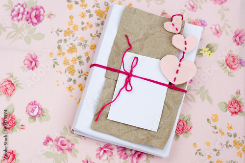 Old notebook for love notes on floral background