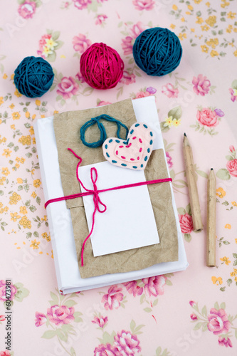Old notebook for love notes and bright yarn balls