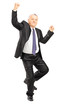 Full length portrait of an ecstatic businessman with hands in th