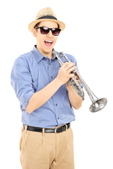 Excited young musician wearing sunglasses and holding a silver t