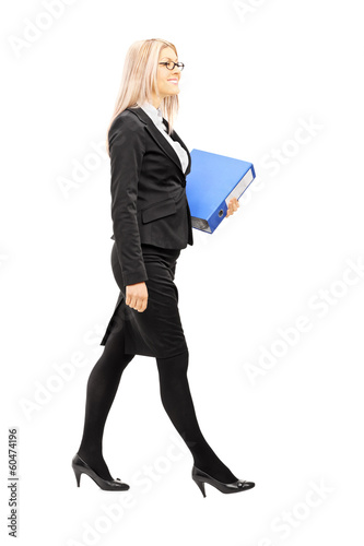 Full length portrait of businesswoman holding a folder