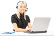 Young female customer service operator working on laptop