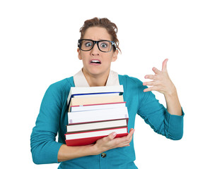 Studying, stressed, worried woman holding a pile of books