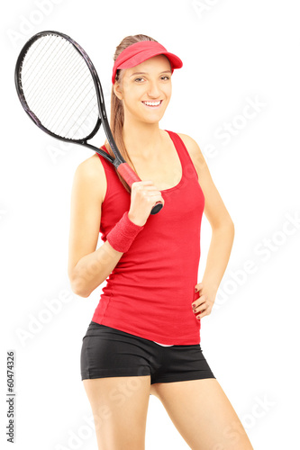 Young female tennis player posing