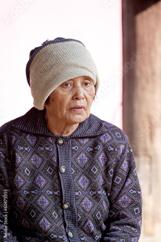 Portrait of elderly woman and cold weather.