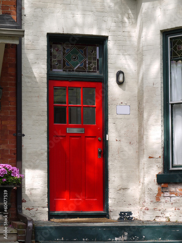 old house with red front door