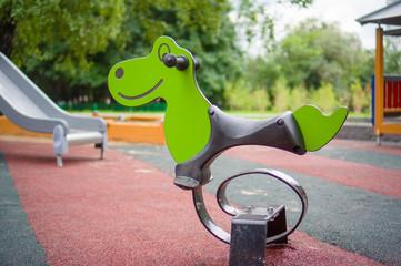 Spring swing in form of animals on modern kids playground