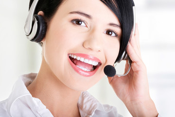 Young call-center assistant smiling at the camera