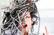 Troubled businesswoman with cables on head