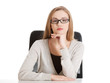Portrait of beautiful attractive woman in eyeglasses. She's sitt